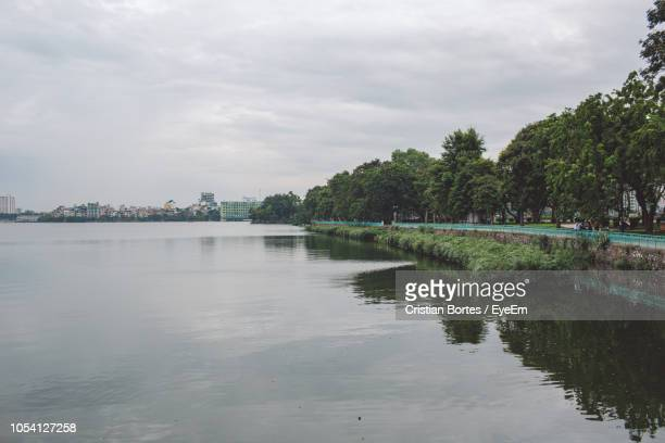 Scenic View Of Lake Against Sky In City