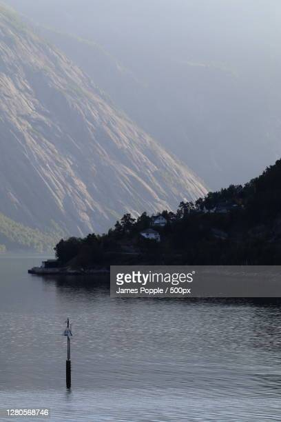 scenic view of lake against sky, ostangvegen, eidfjord, norway - james popple stock pictures, royalty-free photos & images
