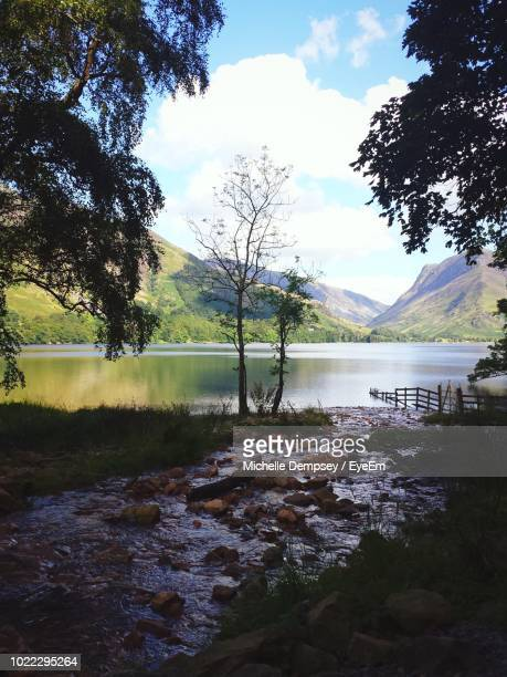 scenic view of lake against sky - cockermouth stock pictures, royalty-free photos & images