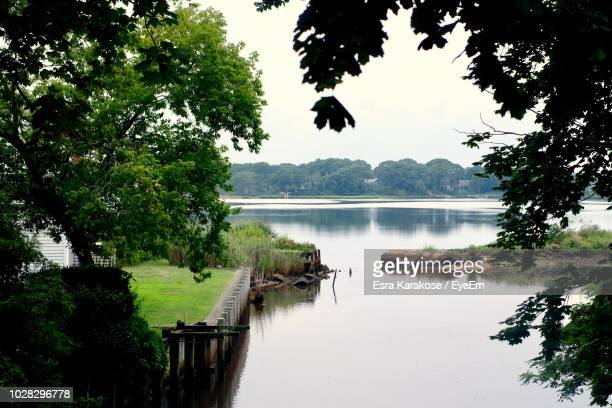 scenic view of lake against sky - sag harbor stock photos and pictures