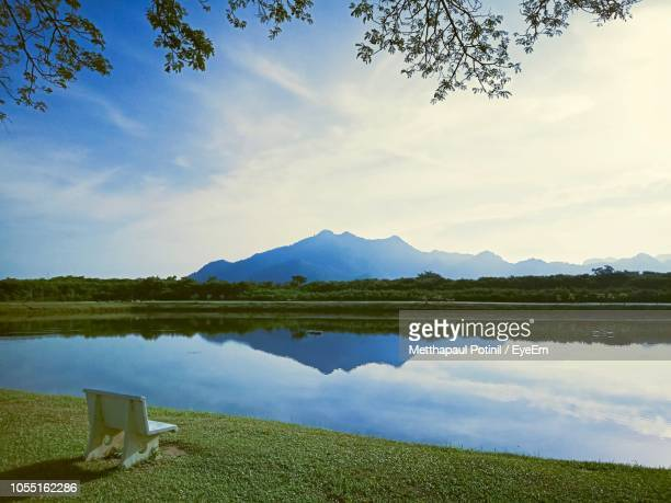 scenic view of lake against sky - metthapaul stock photos and pictures