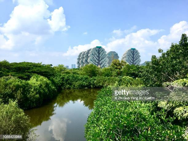 scenic view of lake against sky - hainan island stock pictures, royalty-free photos & images