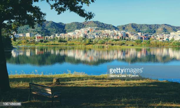 scenic view of lake against sky - tirana stock pictures, royalty-free photos & images