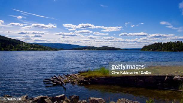scenic view of lake against sky - hordaland county stock pictures, royalty-free photos & images