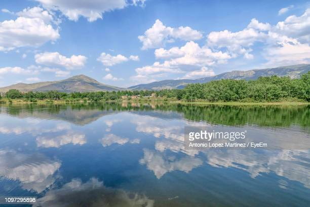 scenic view of lake against sky - segovia stock pictures, royalty-free photos & images