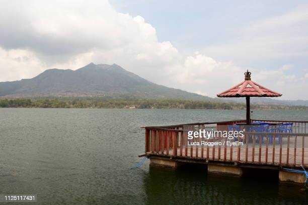 scenic view of lake against sky - kintamani district stock pictures, royalty-free photos & images