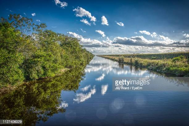 scenic view of lake against sky - everglades national park stock pictures, royalty-free photos & images