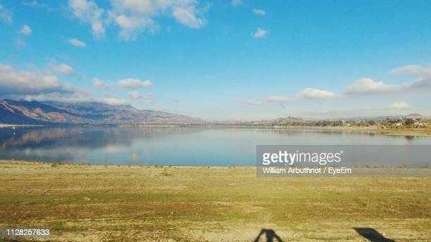 scenic view of lake against sky - lake elsinore stock photos and pictures