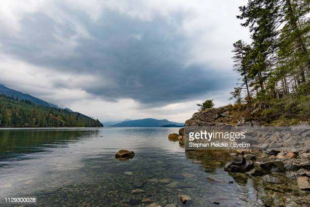 scenic view of lake against sky - coastline stock pictures, royalty-free photos & images