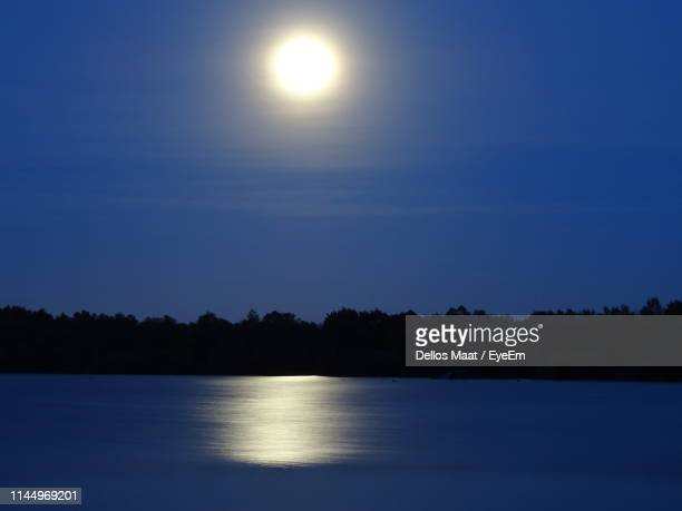 scenic view of lake against sky - moonlight stock pictures, royalty-free photos & images
