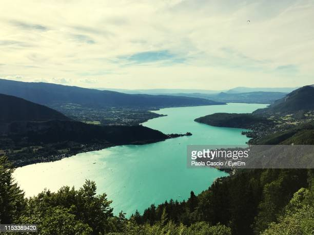 scenic view of lake against sky - annecy photos et images de collection