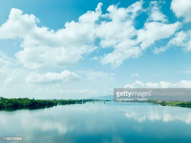 scenic view of lake against sky - 空 ストックフォトと画像