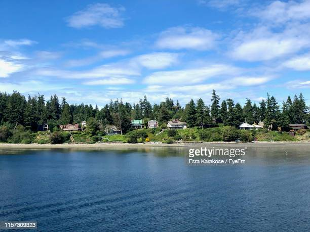 scenic view of lake against sky - bainbridge island stock pictures, royalty-free photos & images