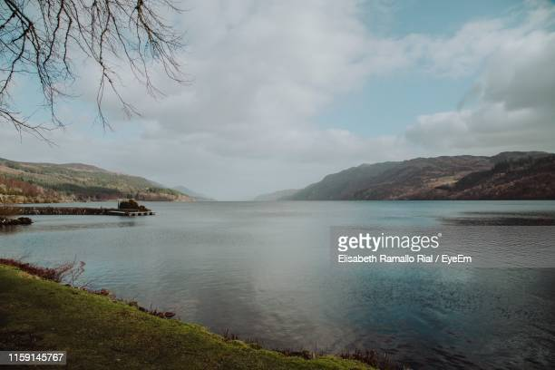 scenic view of lake against sky - loch ness stock pictures, royalty-free photos & images