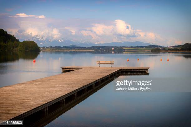 scenic view of lake against sky - jetty stock pictures, royalty-free photos & images