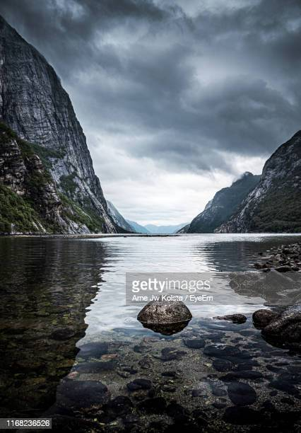 scenic view of lake against sky - arne jw kolstø stock pictures, royalty-free photos & images