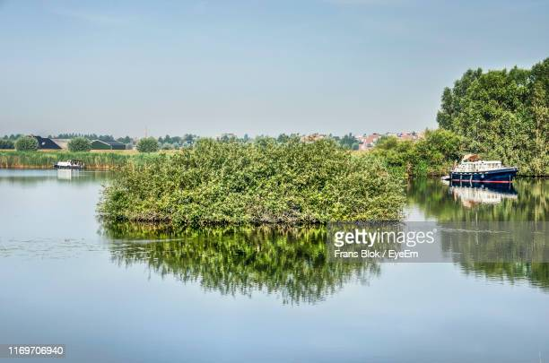 scenic view of lake against sky - overijssel stock pictures, royalty-free photos & images