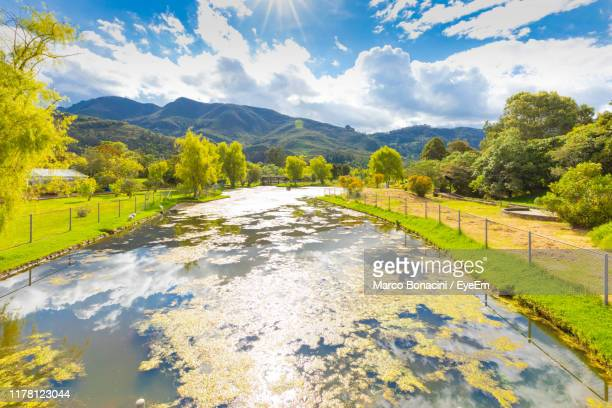 scenic view of lake against sky - cundinamarca stock pictures, royalty-free photos & images