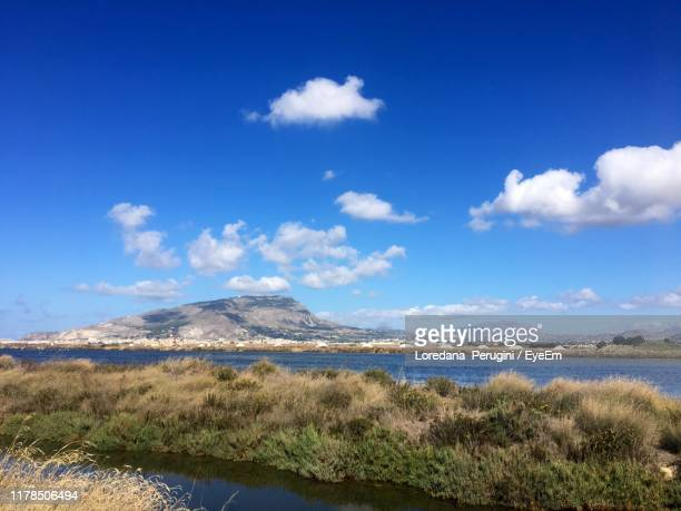 scenic view of lake against sky - loredana perugini stock pictures, royalty-free photos & images