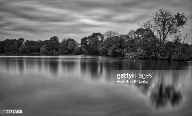 scenic view of lake against sky - andy rinkoff stock photos and pictures