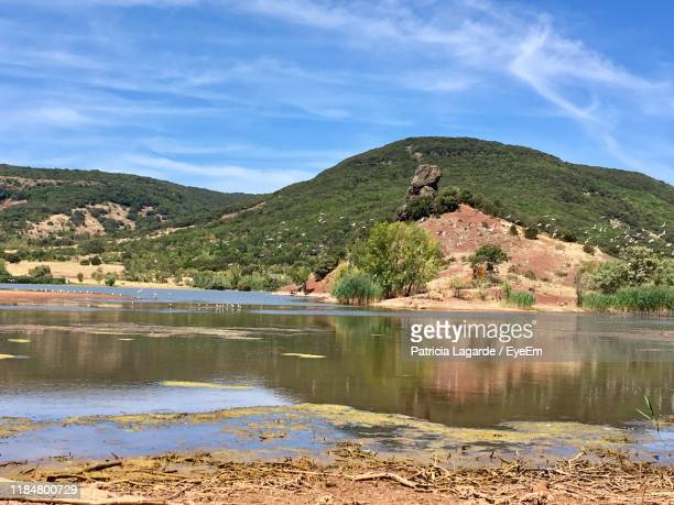 scenic view of lake against sky - lagarde stock pictures, royalty-free photos & images
