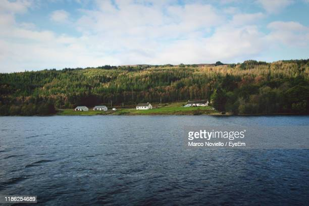 scenic view of lake against sky - glasgow stock pictures, royalty-free photos & images
