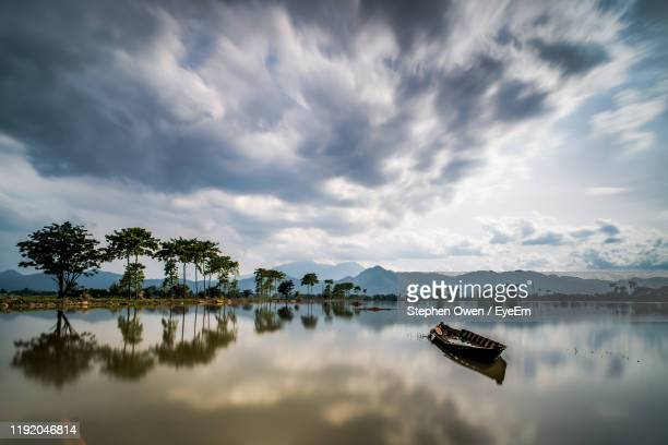 scenic view of lake against sky - bandung stock pictures, royalty-free photos & images