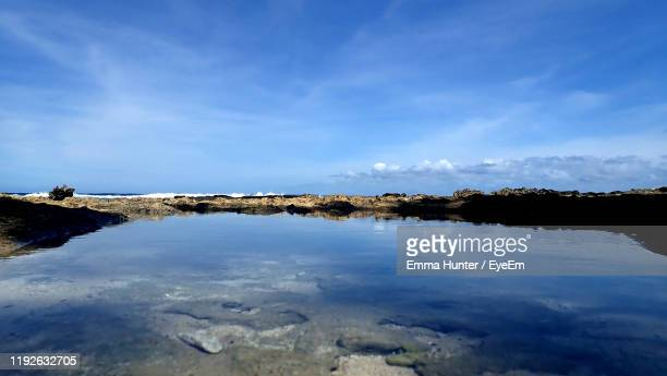 scenic view of lake against sky - emma hunter eye em stock photos and pictures