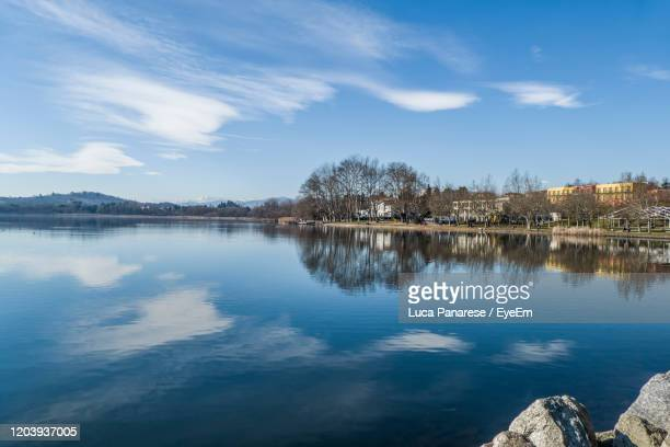 scenic view of lake against sky - varese stock pictures, royalty-free photos & images