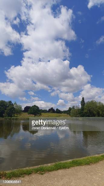 scenic view of lake against sky - highgate stock pictures, royalty-free photos & images