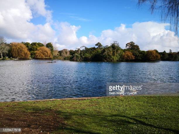 scenic view of lake against sky - wang he stock pictures, royalty-free photos & images