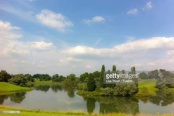 scenic view of lake against sky - district stock pictures, royalty-free photos & images