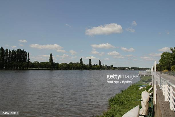 scenic view of lake against sky - allier stock photos and pictures