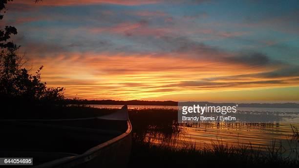 scenic view of lake against sky - sebring stock photos and pictures