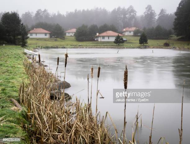 scenic view of lake against sky - pomorskie province stock photos and pictures