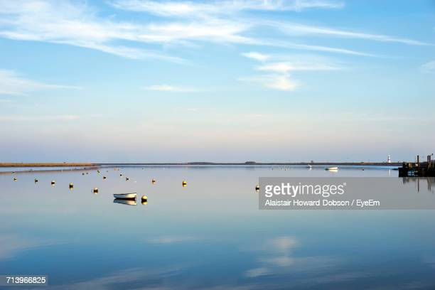 scenic view of lake against sky - aldeburgh stock photos and pictures