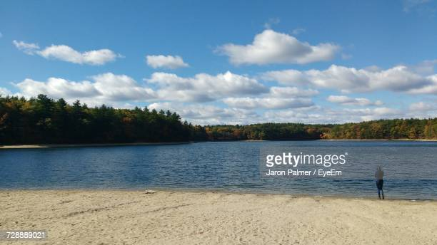 scenic view of lake against sky - walden pond stock pictures, royalty-free photos & images