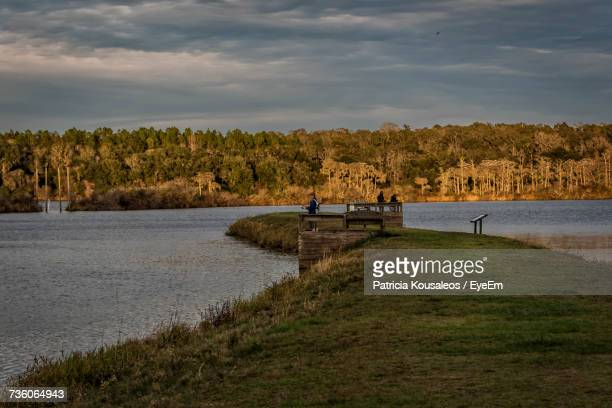 scenic view of lake against sky - tallahassee stock pictures, royalty-free photos & images