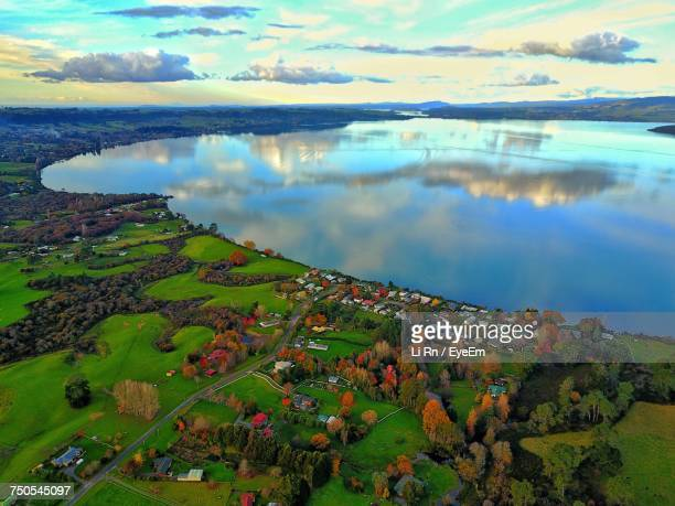 scenic view of lake against sky - rotorua stock pictures, royalty-free photos & images