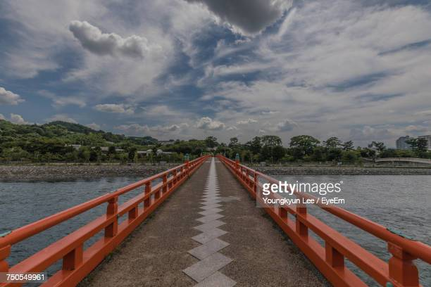scenic view of lake against sky - uji kyoto stock pictures, royalty-free photos & images