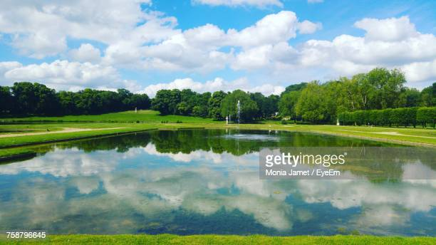 scenic view of lake against sky - chantilly picardy stock pictures, royalty-free photos & images