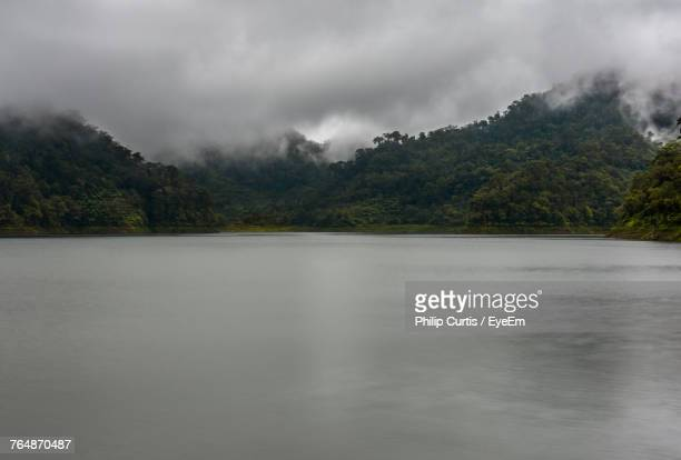 scenic view of lake against sky - negros oriental stock pictures, royalty-free photos & images