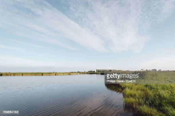 scenic view of lake against sky - mecklenburg vorpommern stock pictures, royalty-free photos & images