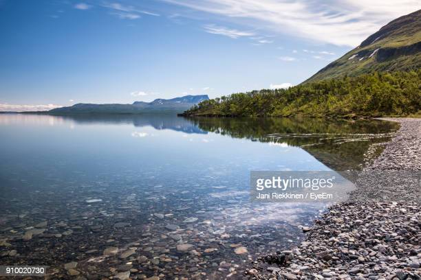 scenic view of lake against sky - norrbotten province stock photos and pictures
