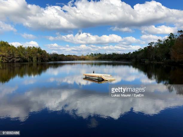scenic view of lake against sky - fort myers stock pictures, royalty-free photos & images