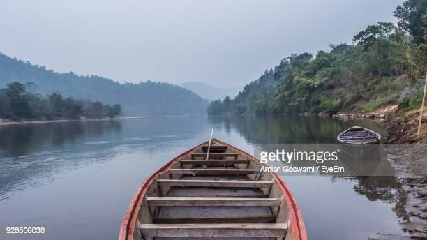 scenic view of lake against sky - guwahati stock photos and pictures