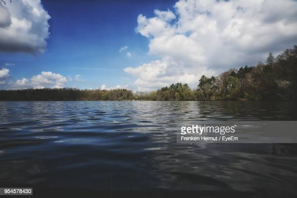 scenic view of lake against sky - low angle view stock pictures, royalty-free photos & images