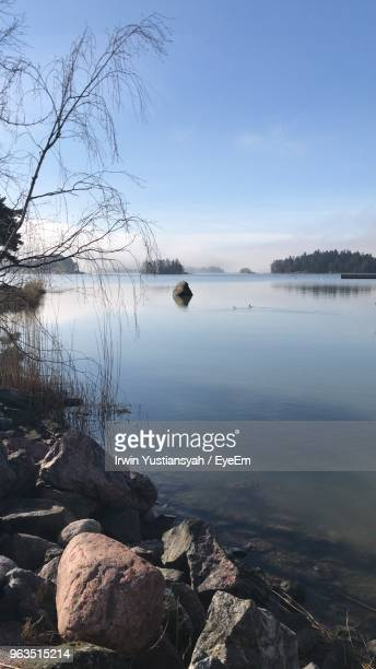 scenic view of lake against sky - espoo stock pictures, royalty-free photos & images