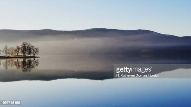 scenic view of lake against sky - reflection lake stock pictures, royalty-free photos & images