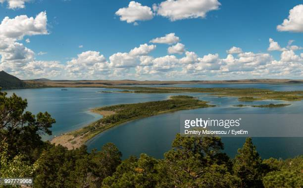 scenic view of lake against sky - kazakhstan stock pictures, royalty-free photos & images